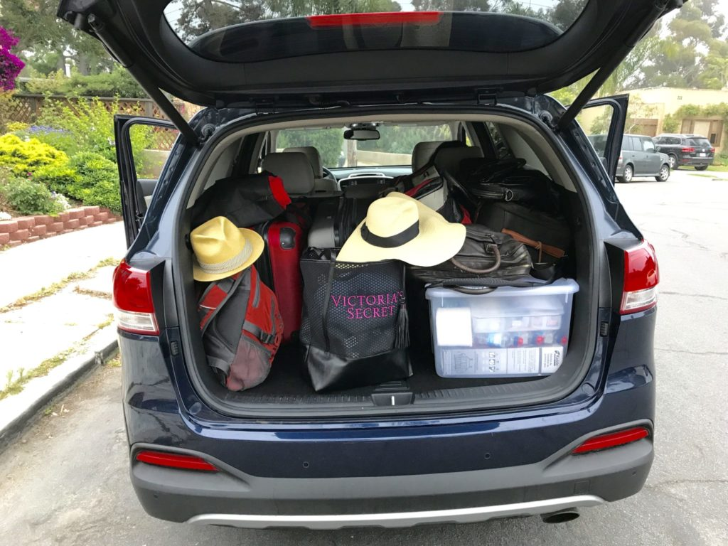 car trunk packed full of suitcases