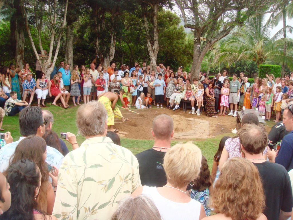 Watching the imu ceremony at Smith Family Garden Luau