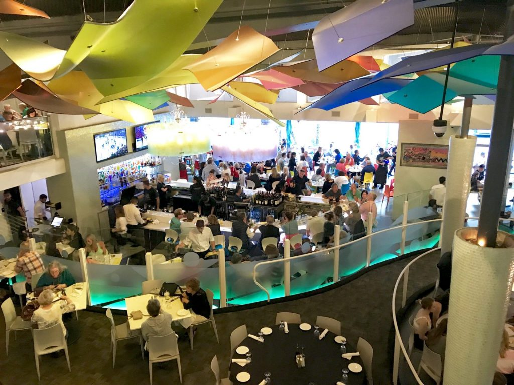 Lulu California Bistro in Palm Springs interior view with colorful art