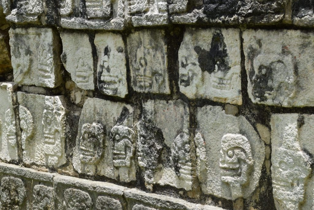 wall with skeleton heads at Chichen Itza
