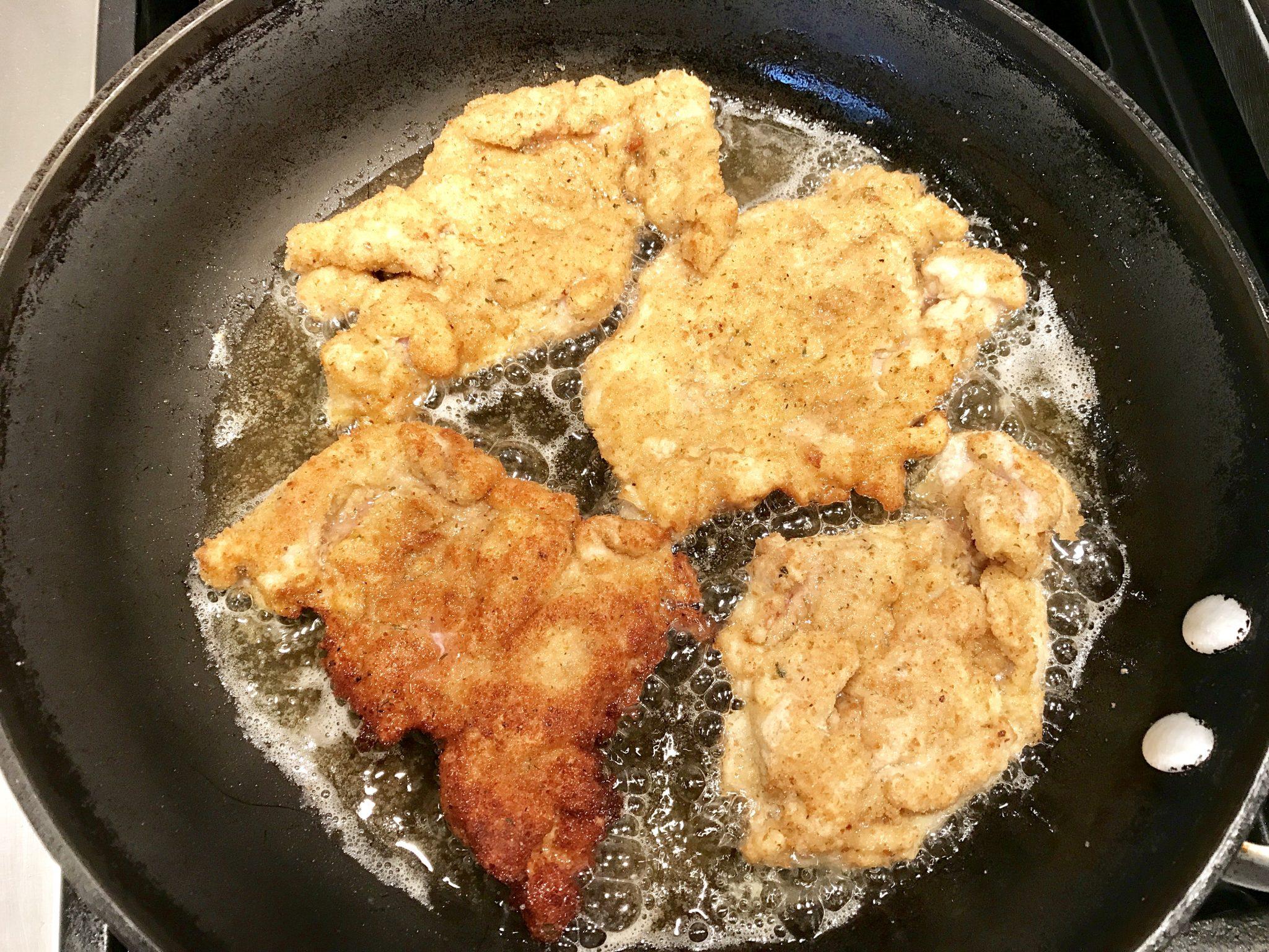 chicken thighs frying