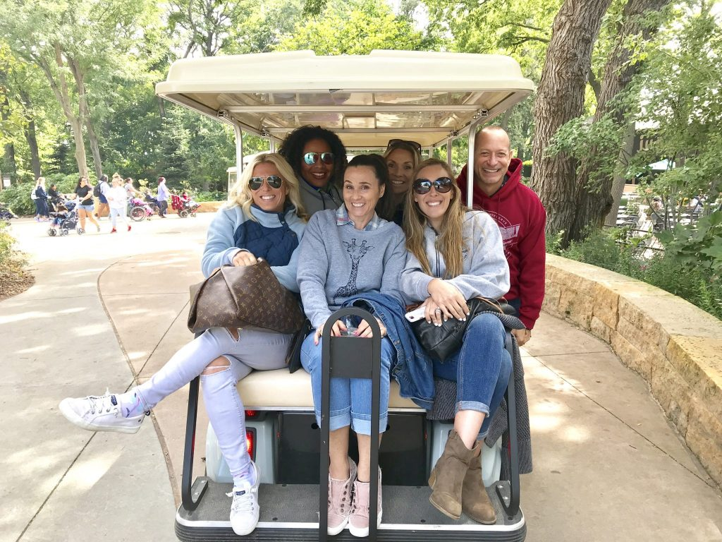 people on golf cart at Omaha Zoo