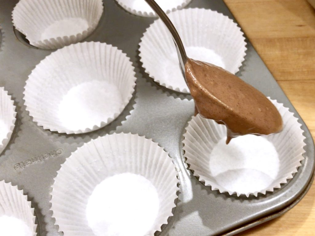pouring chocolate batter into cupcake pan