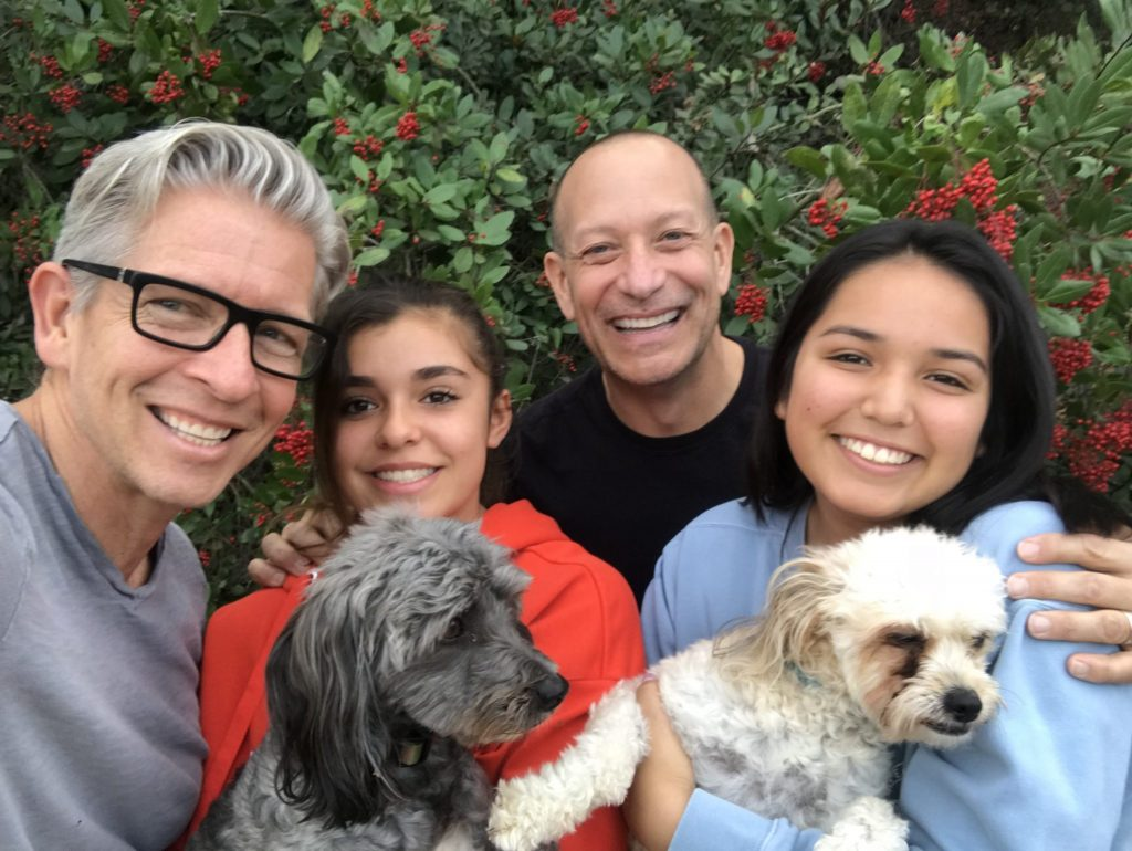 LGBTQ family on hiking trail with dogs