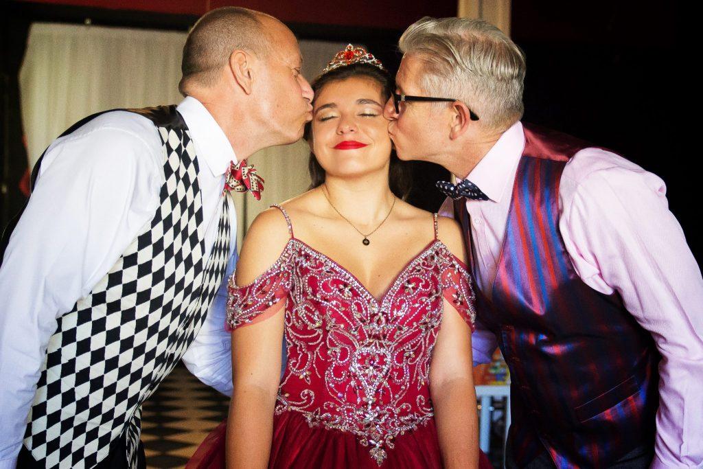 Quinceañera getting kissed on cheek