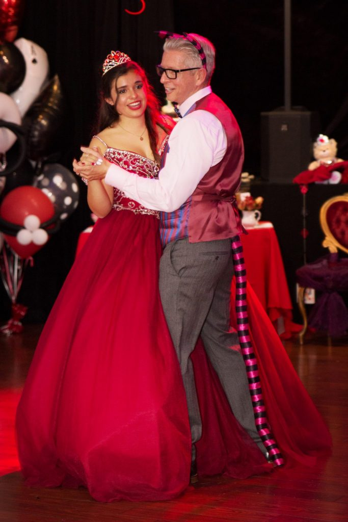Quinceañera and father dance first waltz