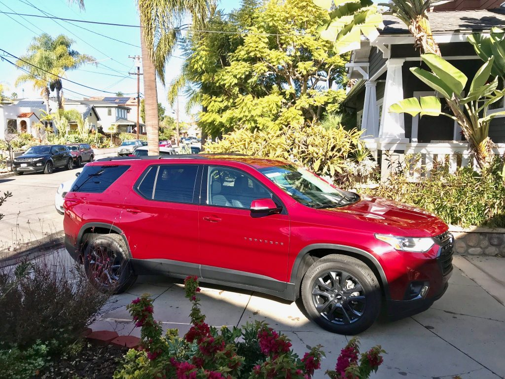 red 2019 Chevrolet Traverse in driveway