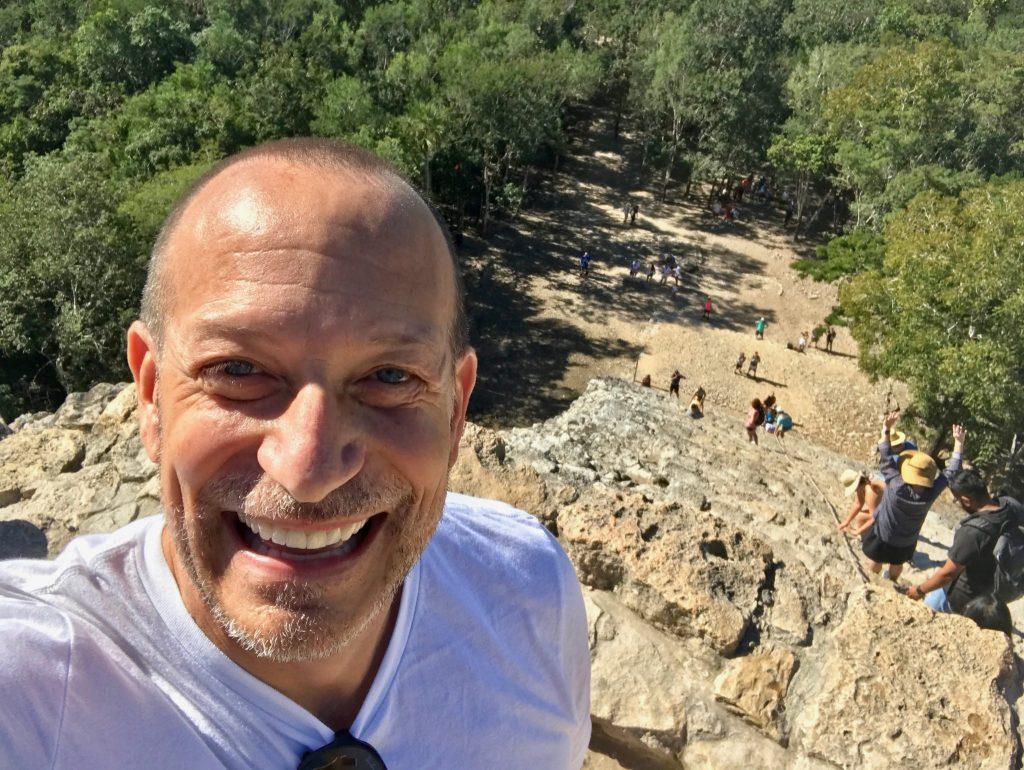 climbing down Nohoch Mol Pyramid at Coba