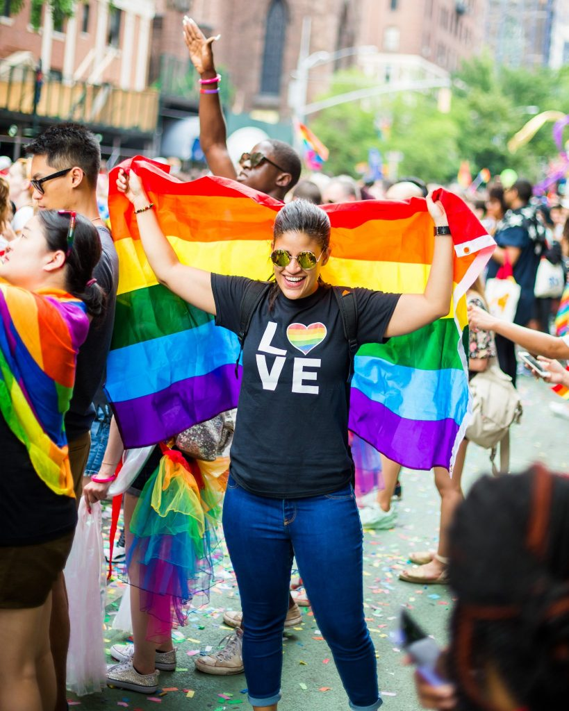 girl with rainbow flag at PrideFest NYC