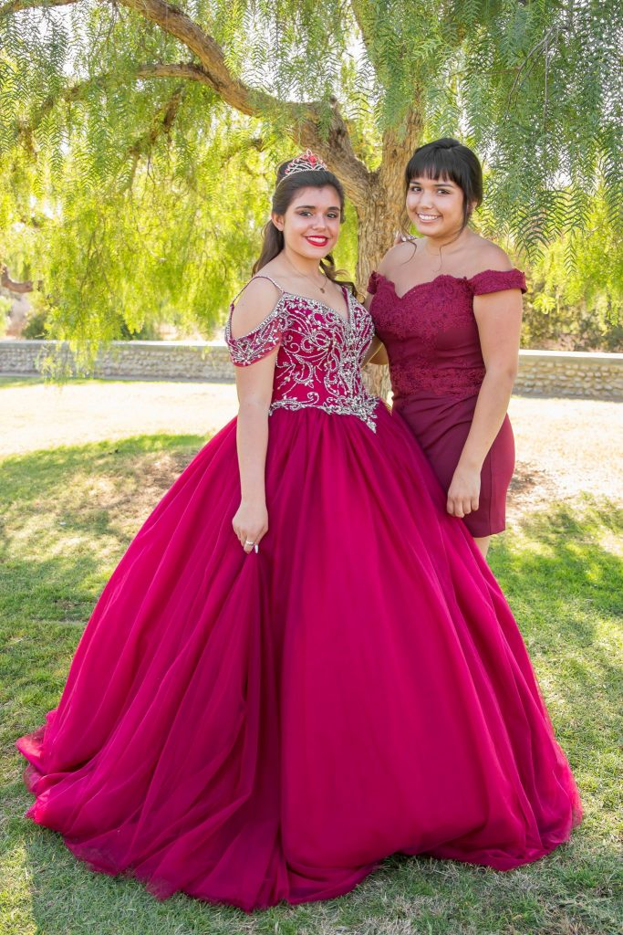quinceañera sisters in gown and crown