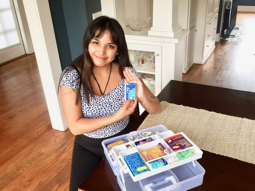 girl with box of eye drops