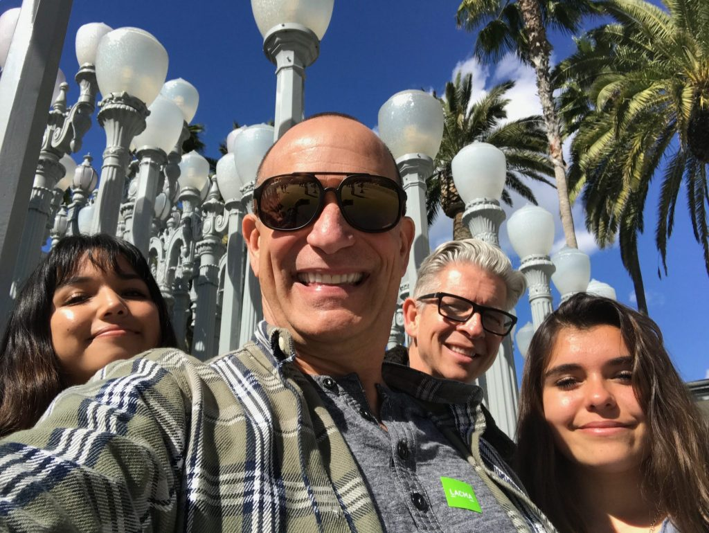 family selfie with LACMA lamp posts