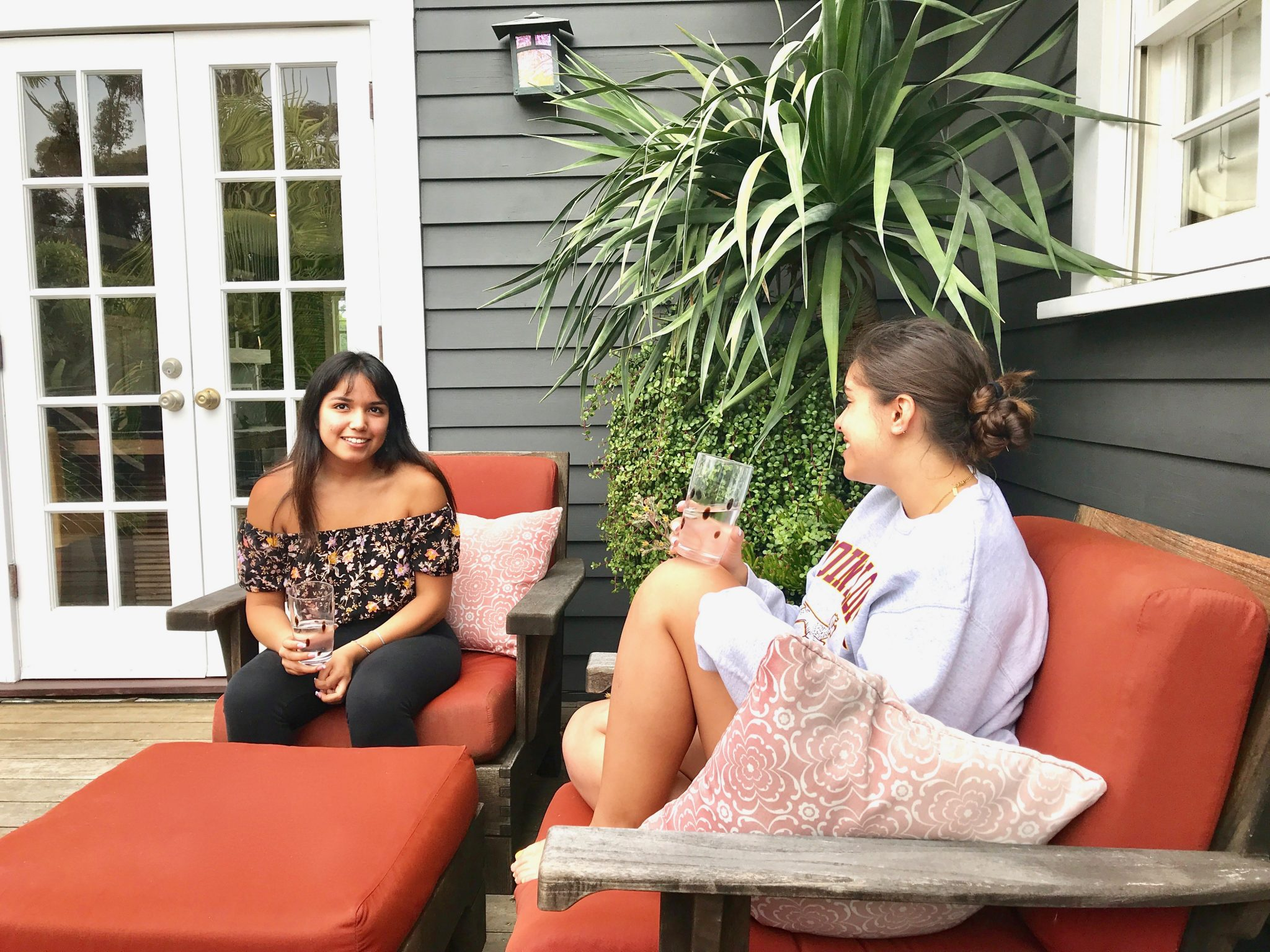 Girls on back porch with water
