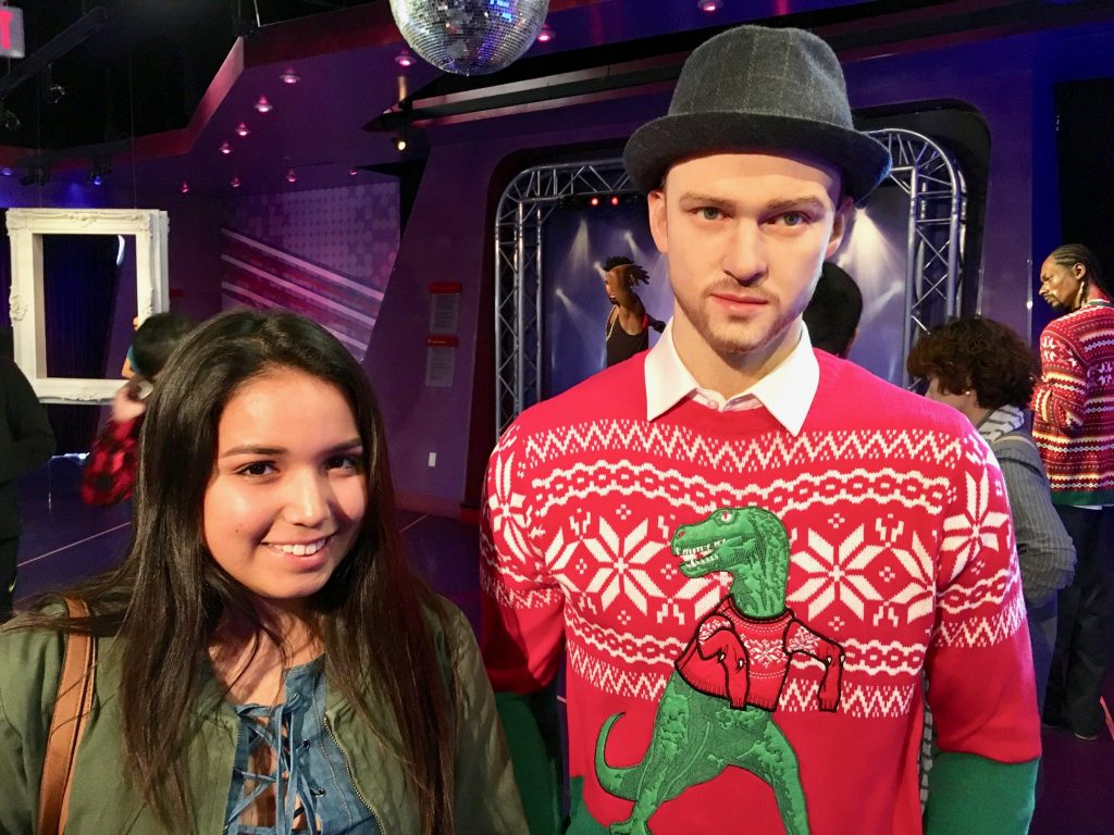 girl with Justine Timberlake wax figure at Madame Tussaud's Hollywood