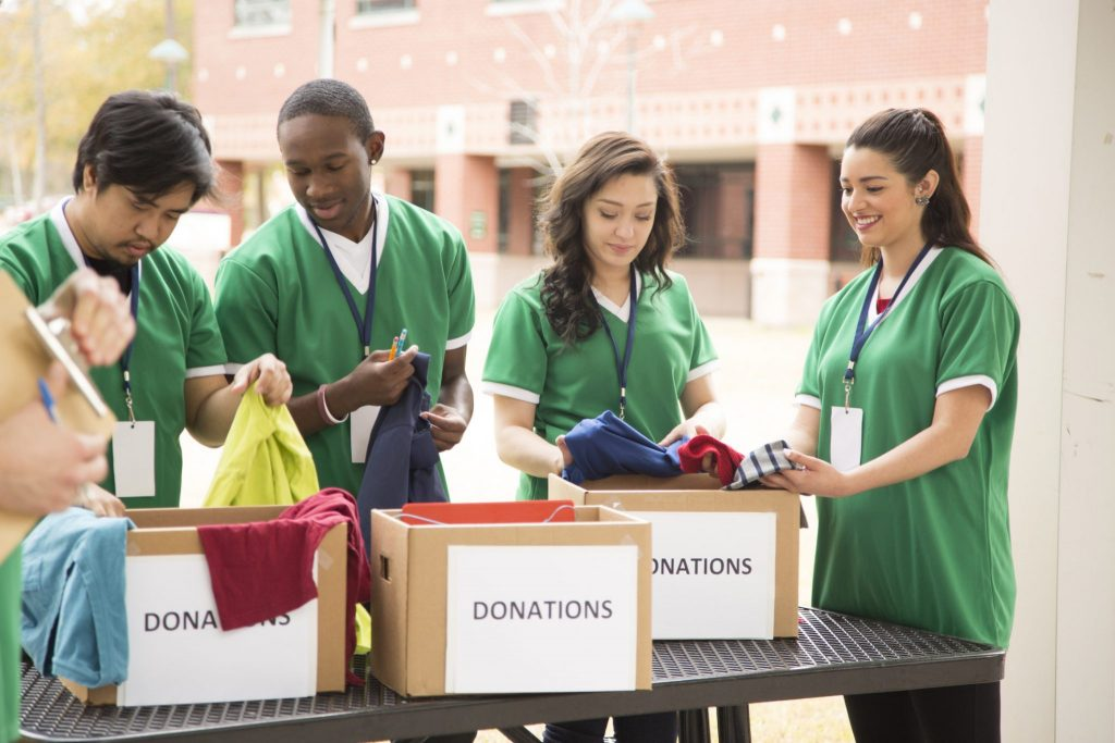 student volunteers with donation boxes