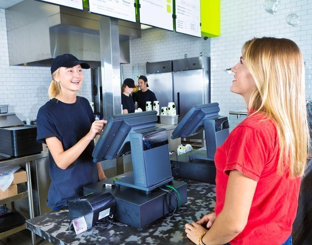 Checkout Server Serving Young Woman Customer Ordering at Fast Food Restaurant
