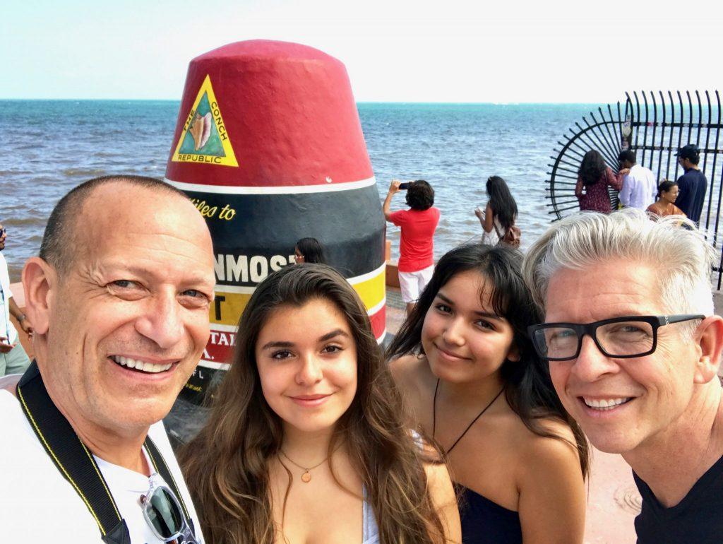 family at southernmost point marker Key West