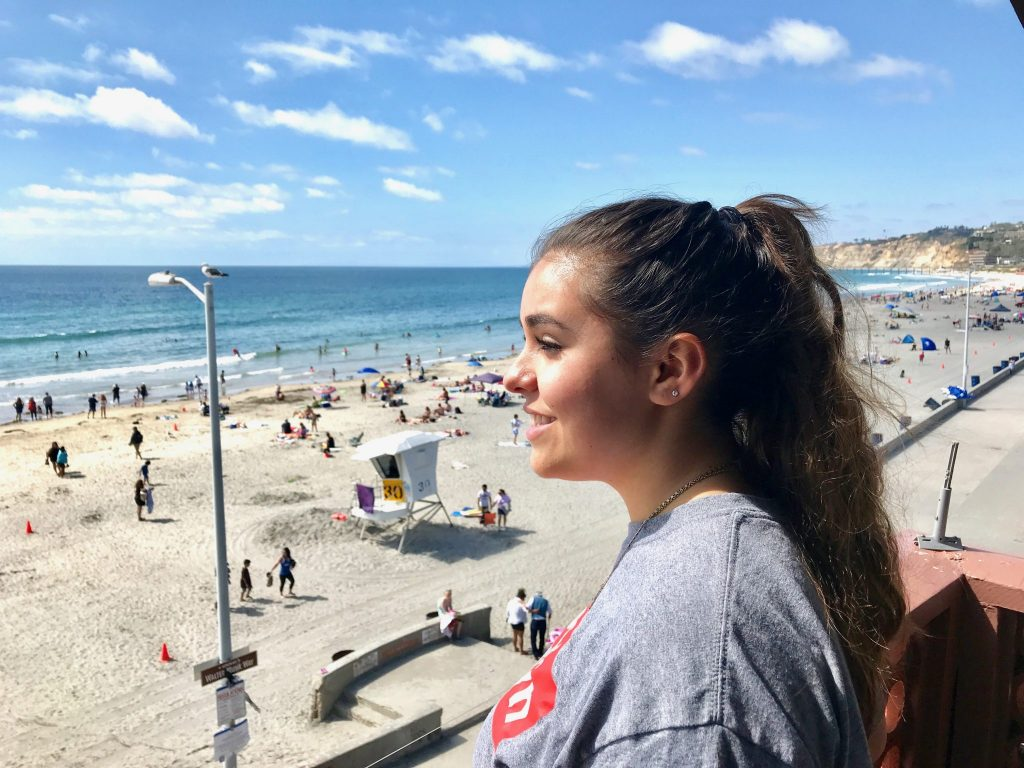 girl views beach from balcony at La Jolla Shores Hotel