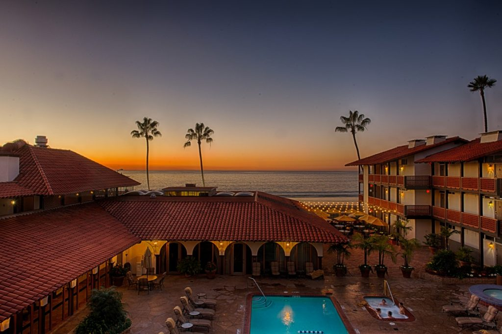 sunset over pool at La Jolla Shores Hotel