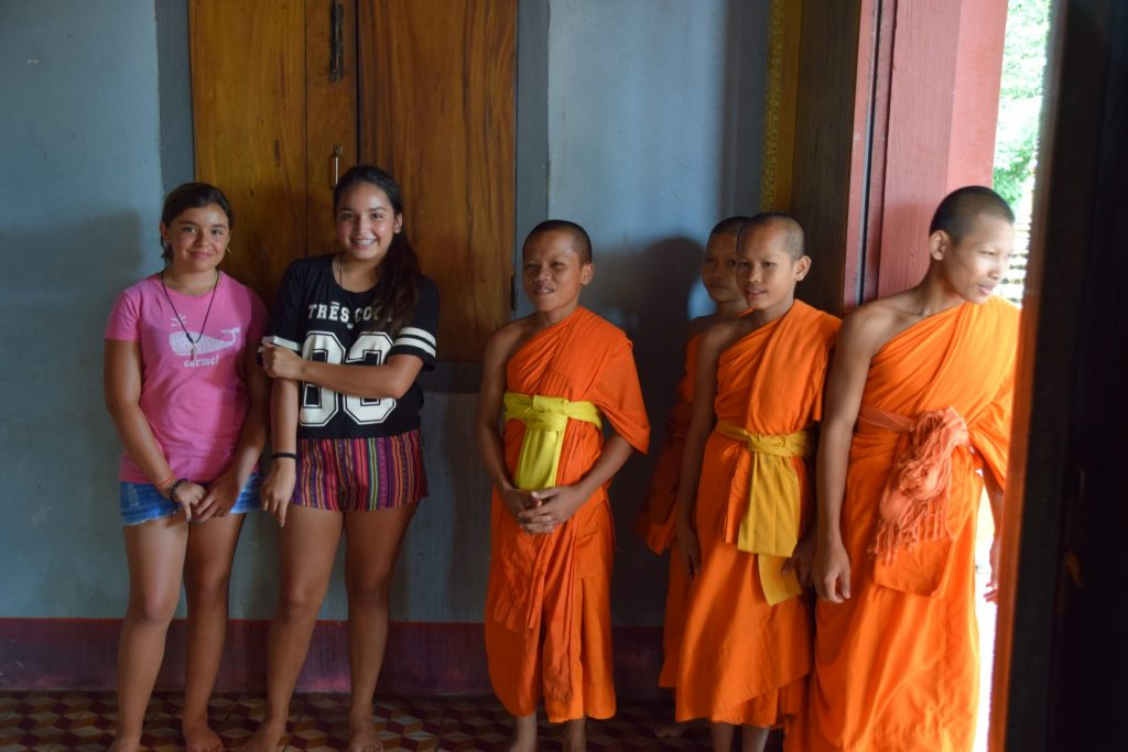 Young monks in training at Cambodian monastery with American girls