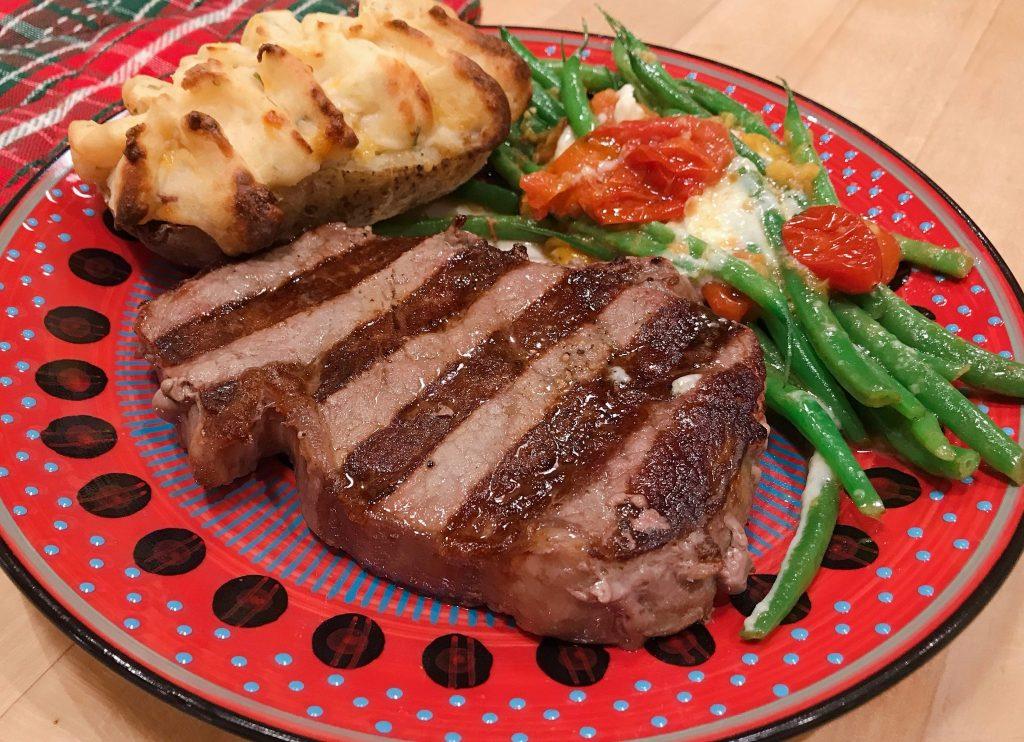 plated huge steak dinner