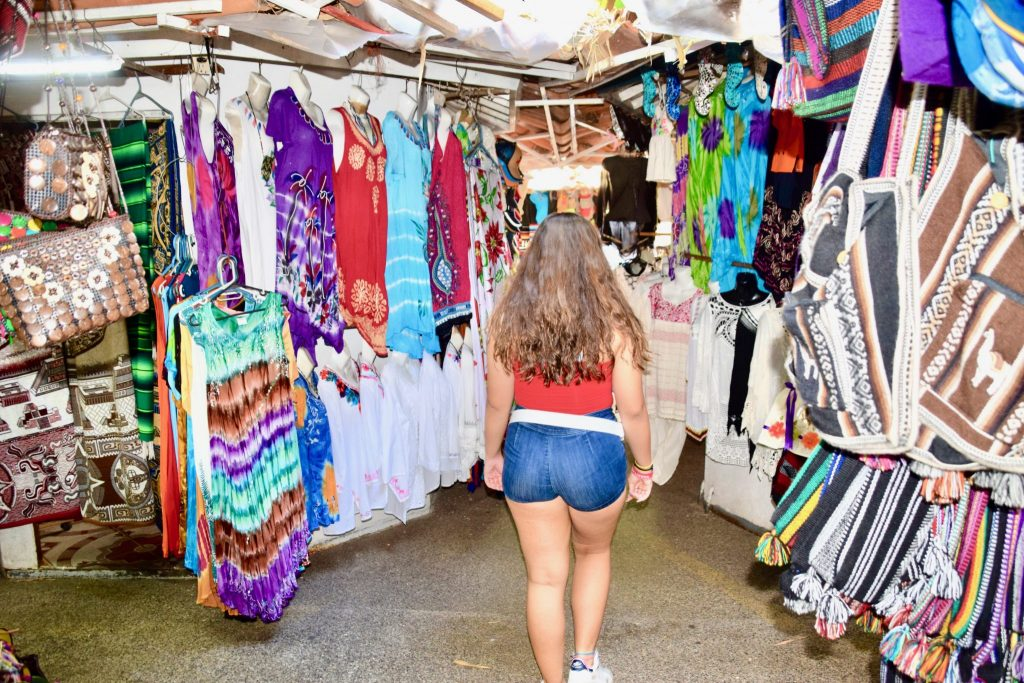 girl shopping in Puerto Vallarta outdoor bazaar