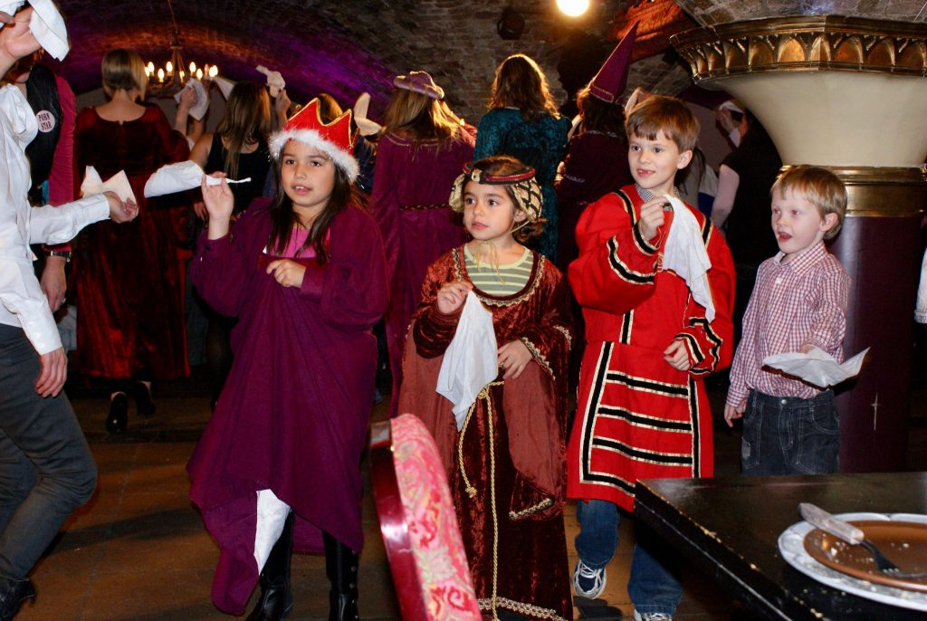 little kids role playing as Kings and Queens in London, England