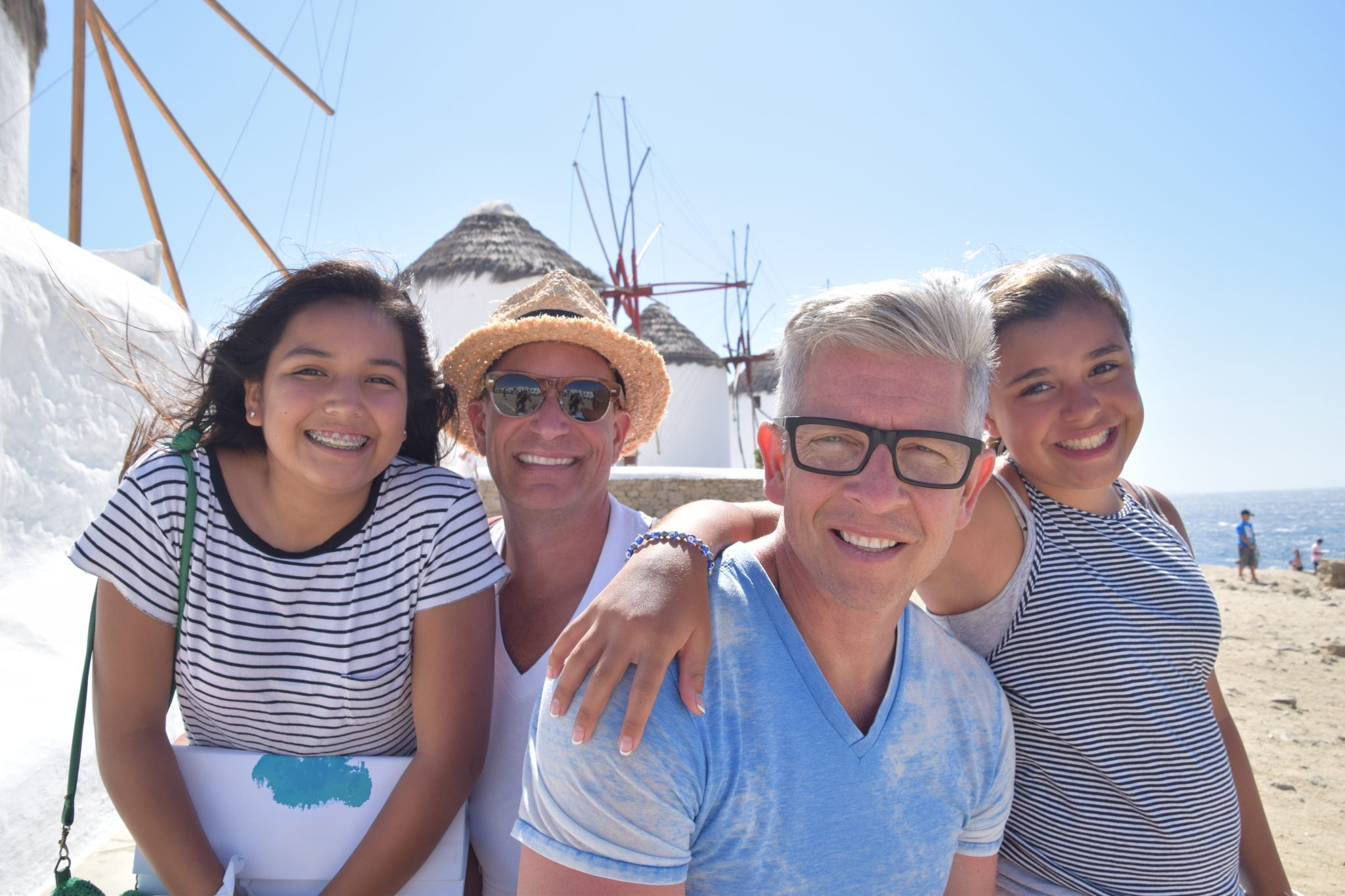 family with 2 dads in Mykonos, Greece