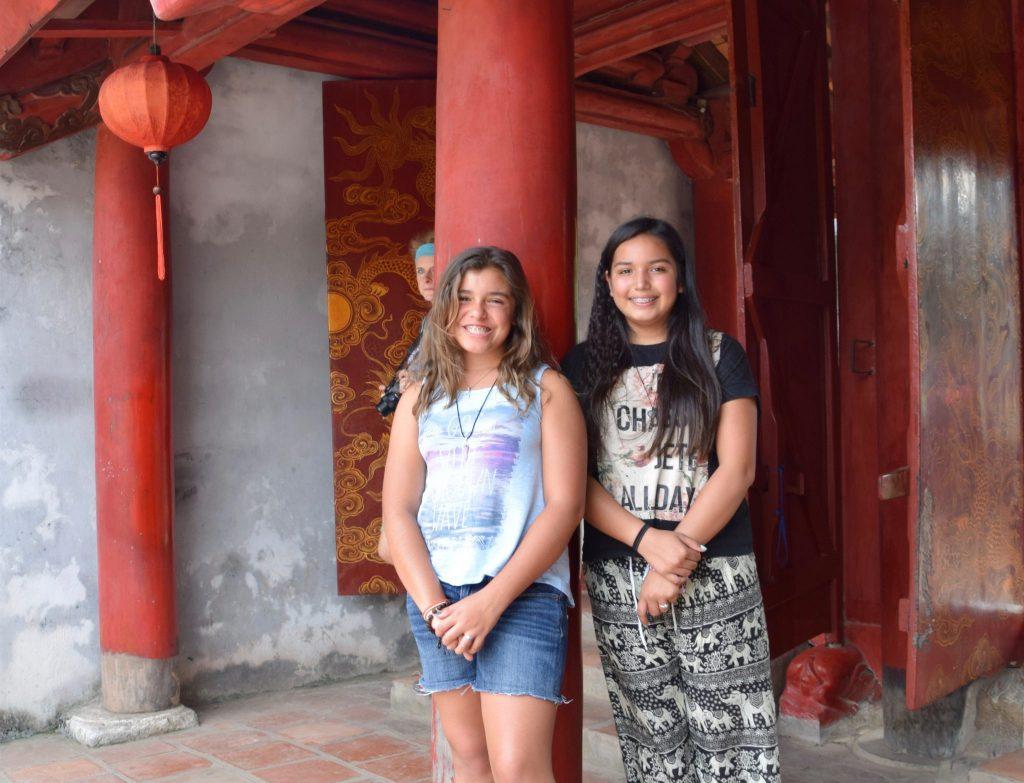 two girls visiting temple in Hanoi, Vietnam