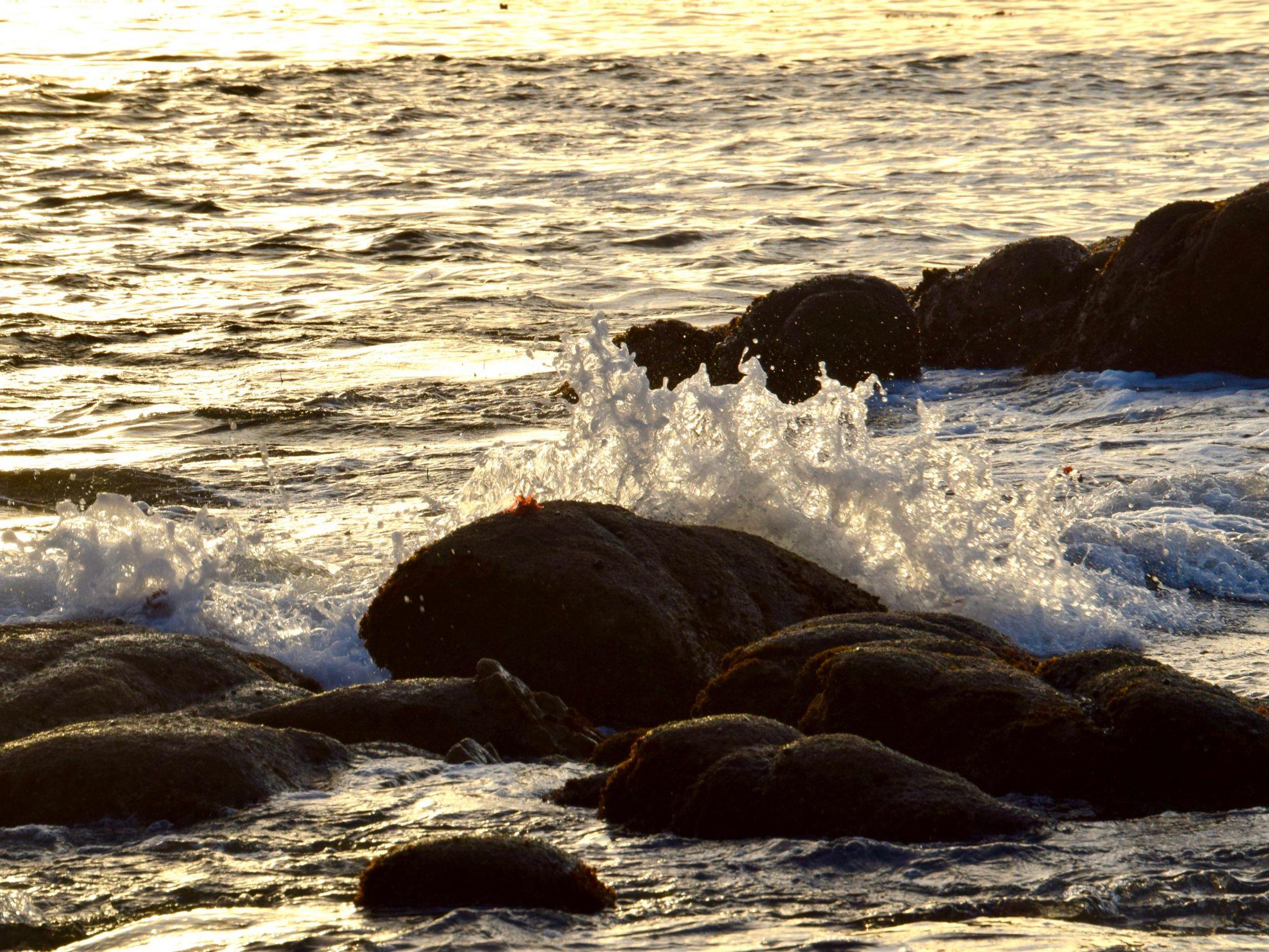 waves splash on rocks at Cannery Row, Monterey, California