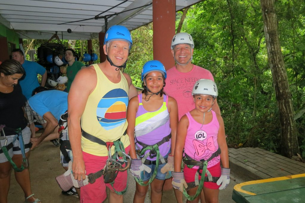 family with 2 dads ziplining in Costa Rica