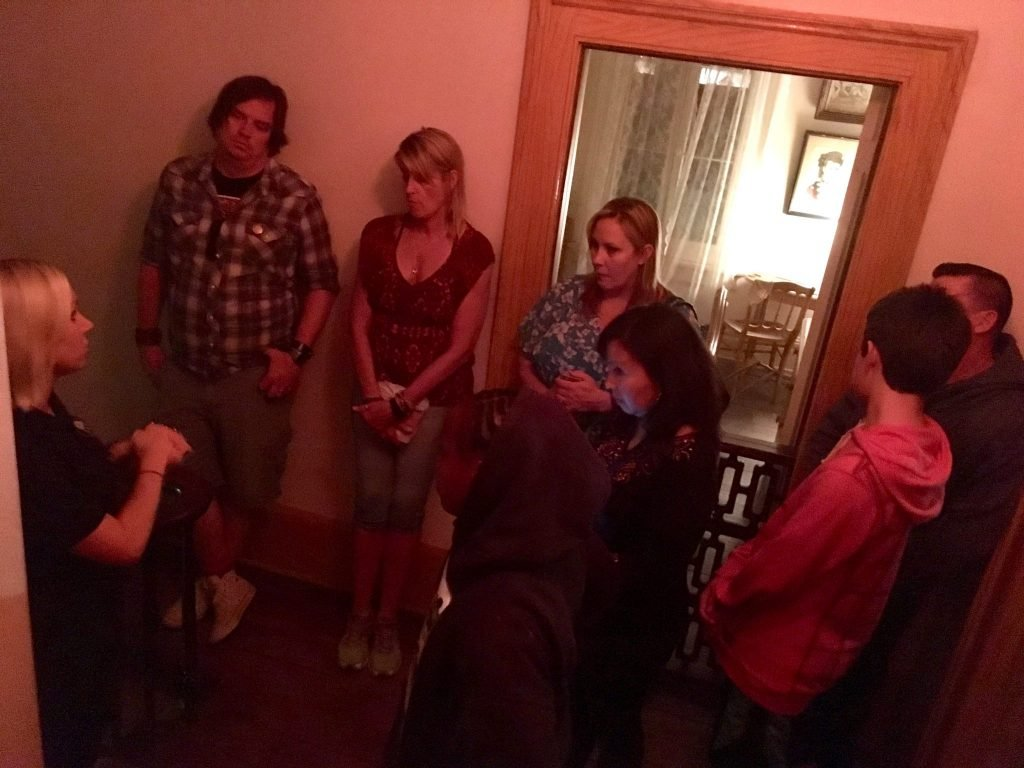 tour group inside The Whaley House in San Diego