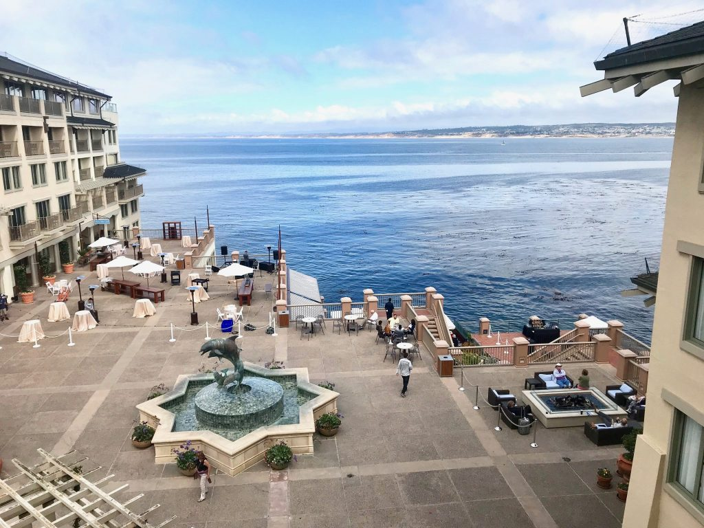 Room view of plaza, fountain and Monterey Bay at the Monterey Plaza Hotel & Spa