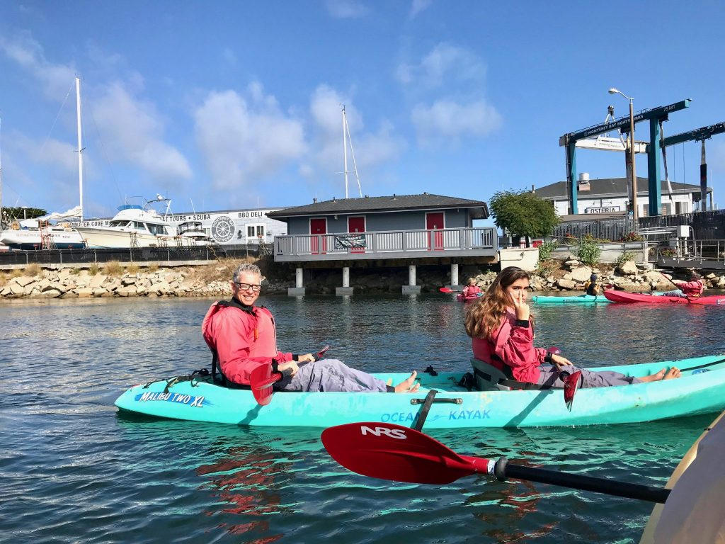 Father and daughter kayaking in Monterey Bay