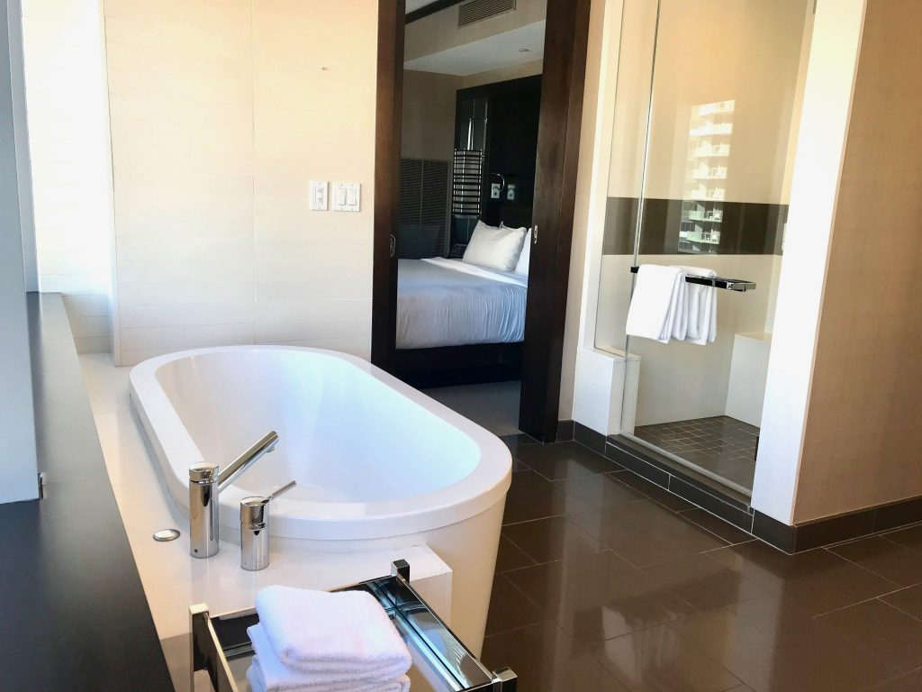 Master bathroom with soaking tub and walk-in shower in the corner suite at Vdara Hotel in Las Vegas