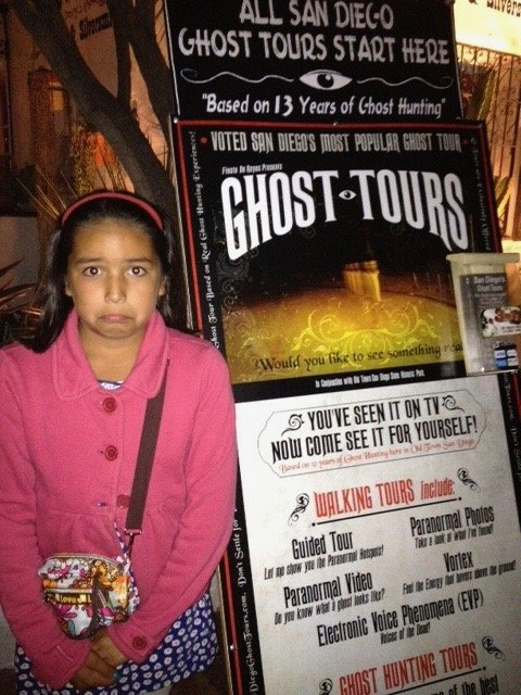 girls with ghost tours sign in Old Town, San DIego