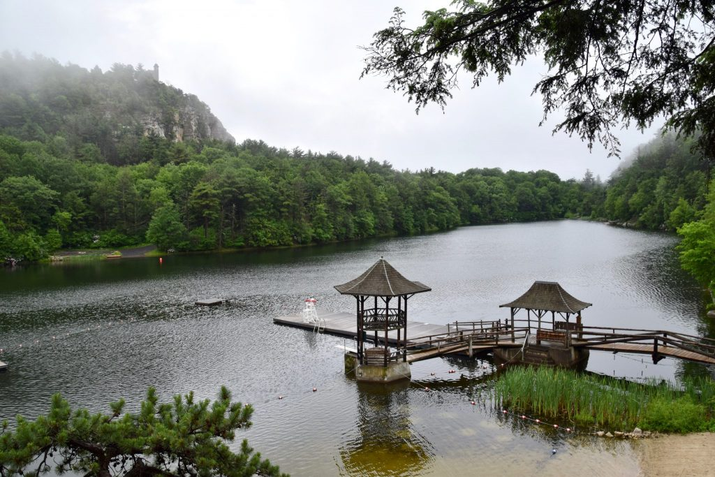 morning mist over Mohonk Lake with swimming dock and gazebos, Mohonk Mountain House, New York