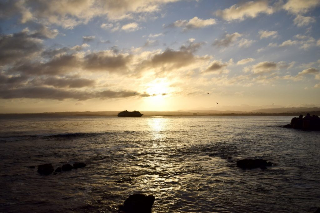 Monterey Bay at sunrise with cruise ship