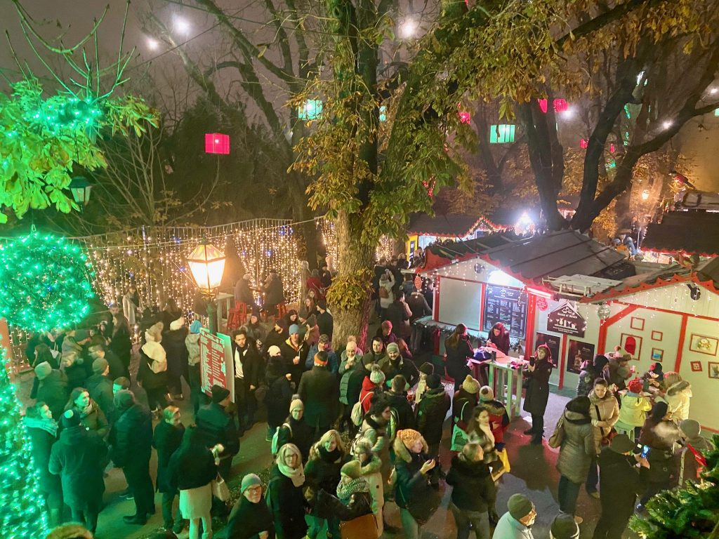 brightly colored lights and decorations among Advent Market stalls in Zagreb, Croatia