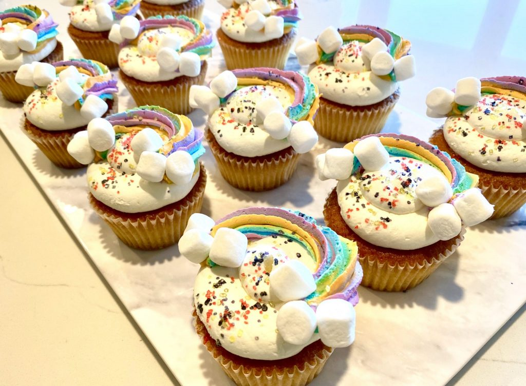 rainbow cupcakes with marshmallow clouds