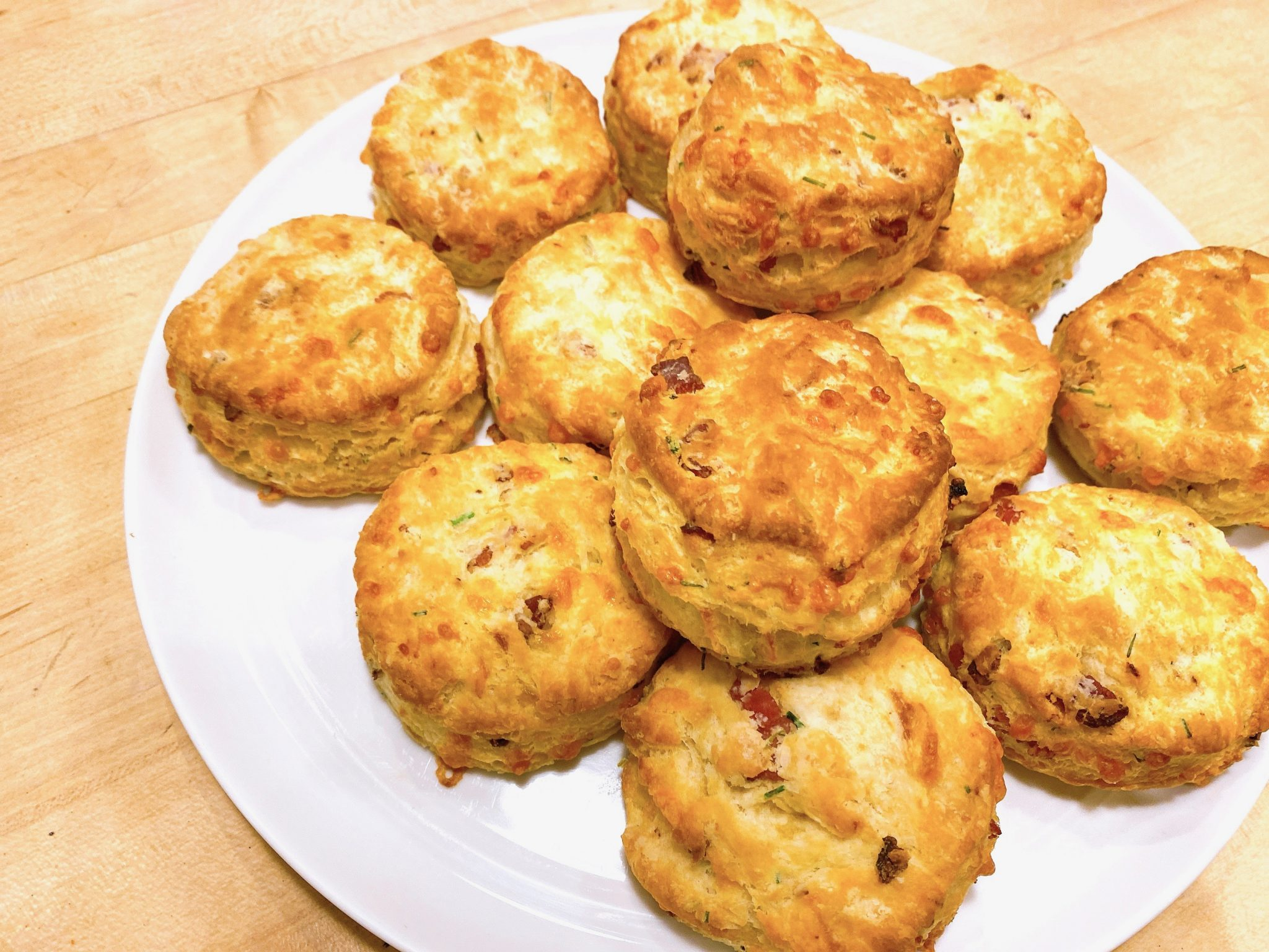 large plate of homemade bacon cheddar biscuits