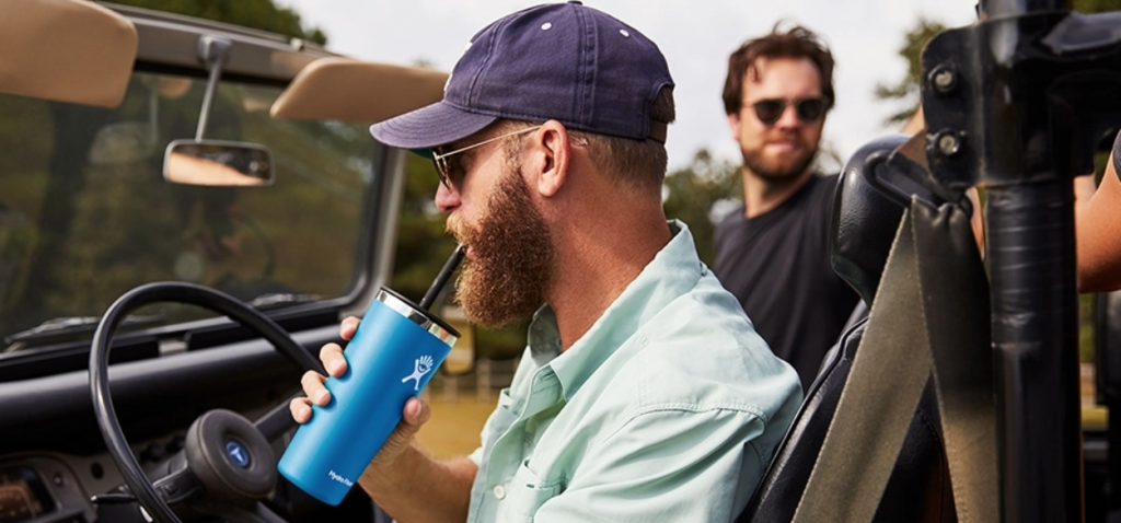 HydroFlask tumbler with man in jeep