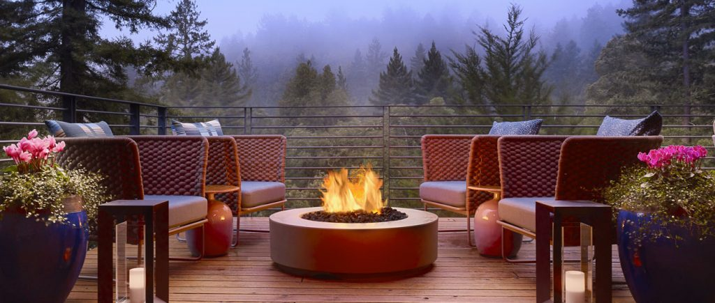 deck chairs and firepit overlooking the foggy woods at Canyon Ranch Woodside in Woodside, CA