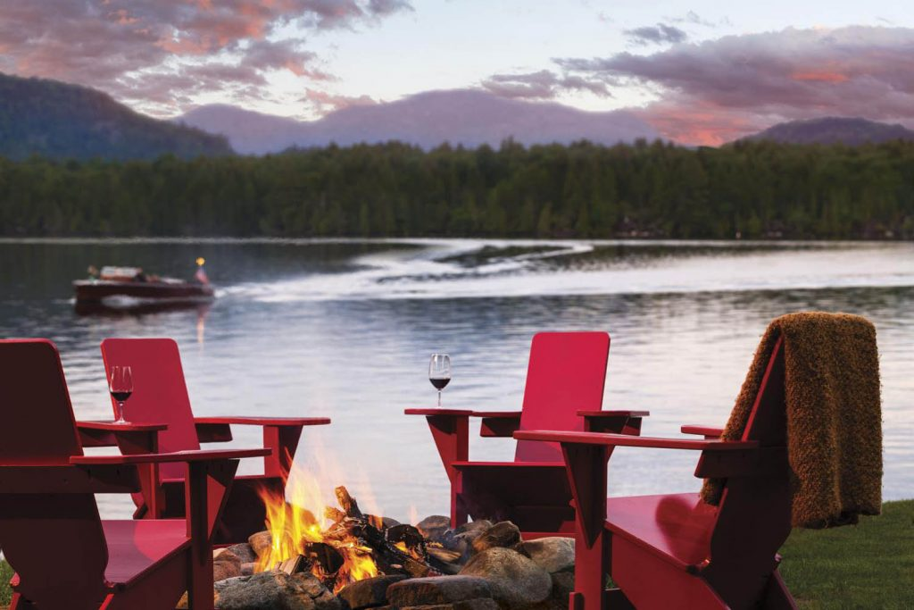 Lakeside firepit and chairs at the Lake Placid Lodge in New York