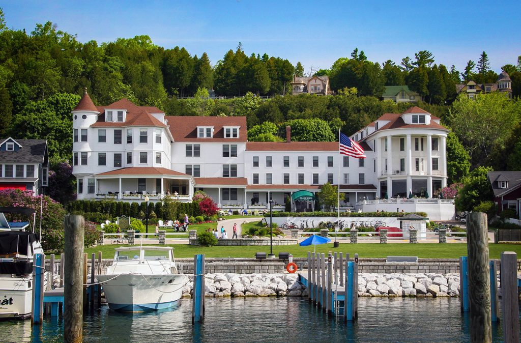 Iconic as always, the Island House Hotel sits lakeside in Mackinac,
