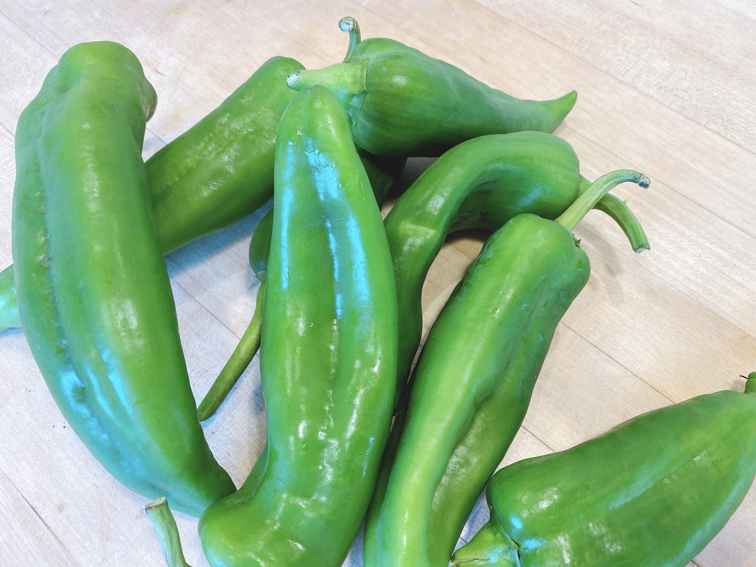 homegrown bright green anaheim chiles from a backyard garden