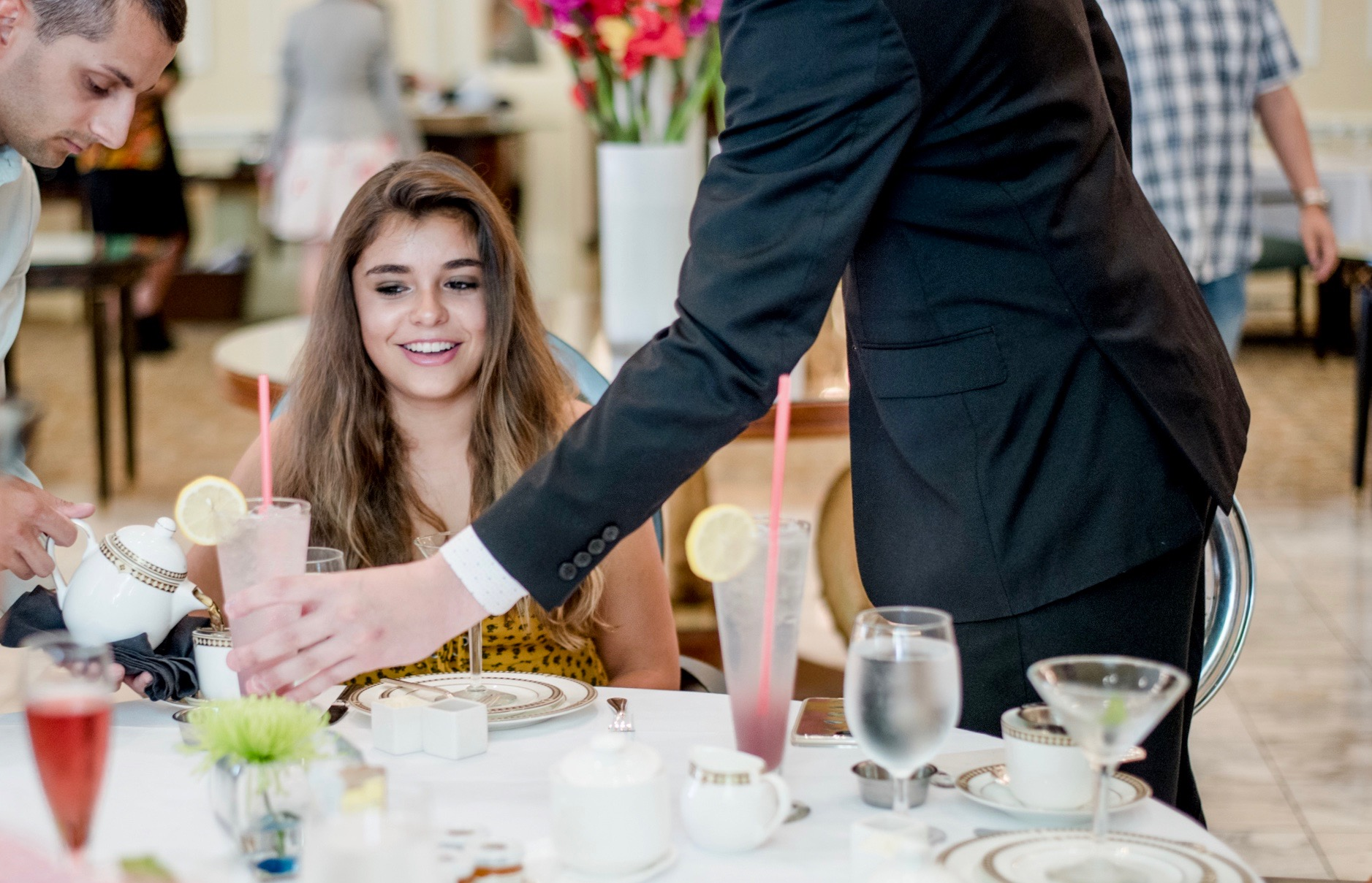 girl is waited on by attentive staff during High Tea at the Fairmont Olympic Hotel in Seattle, WA