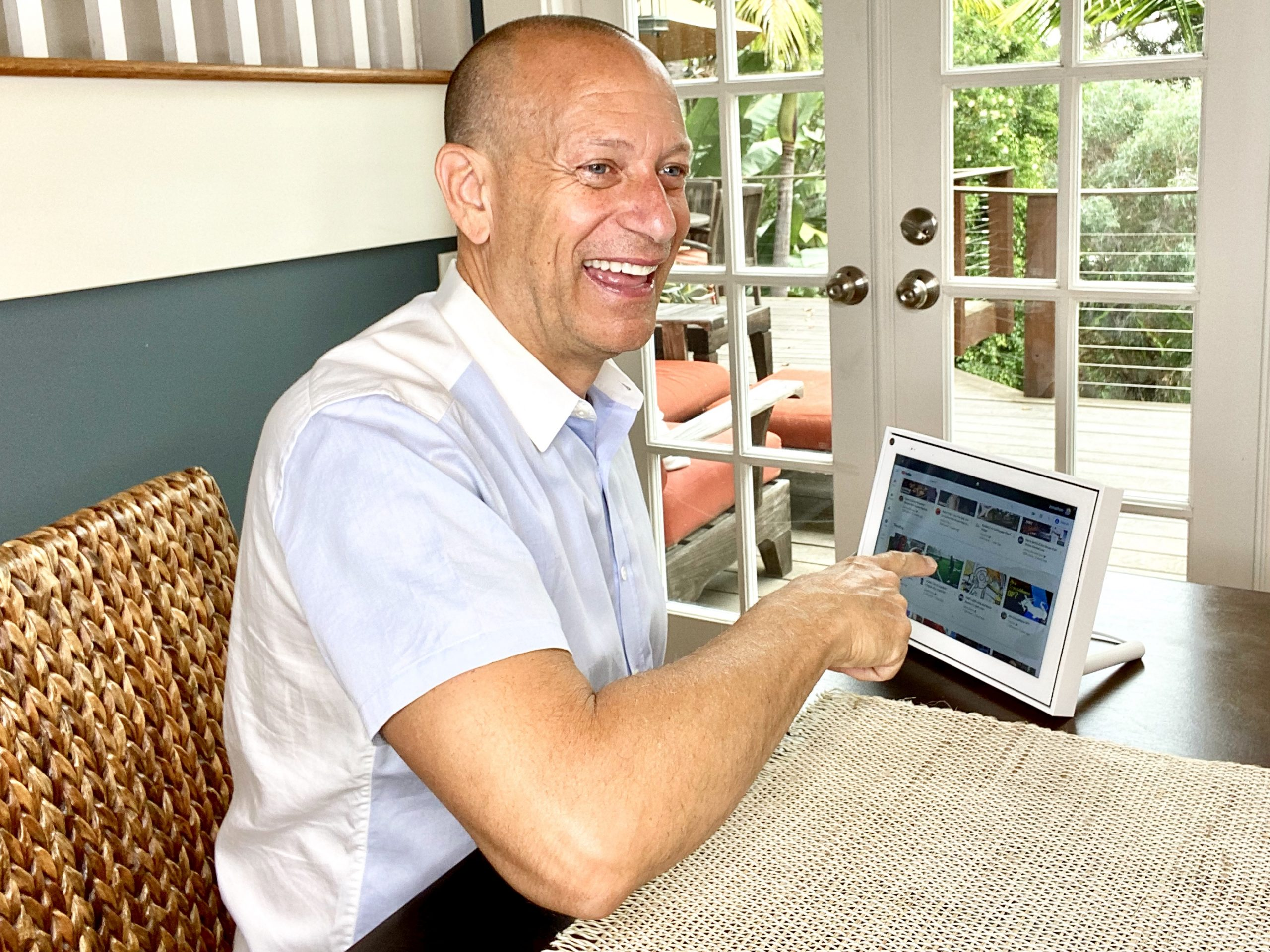 Man watching videos on Portal by Facebook