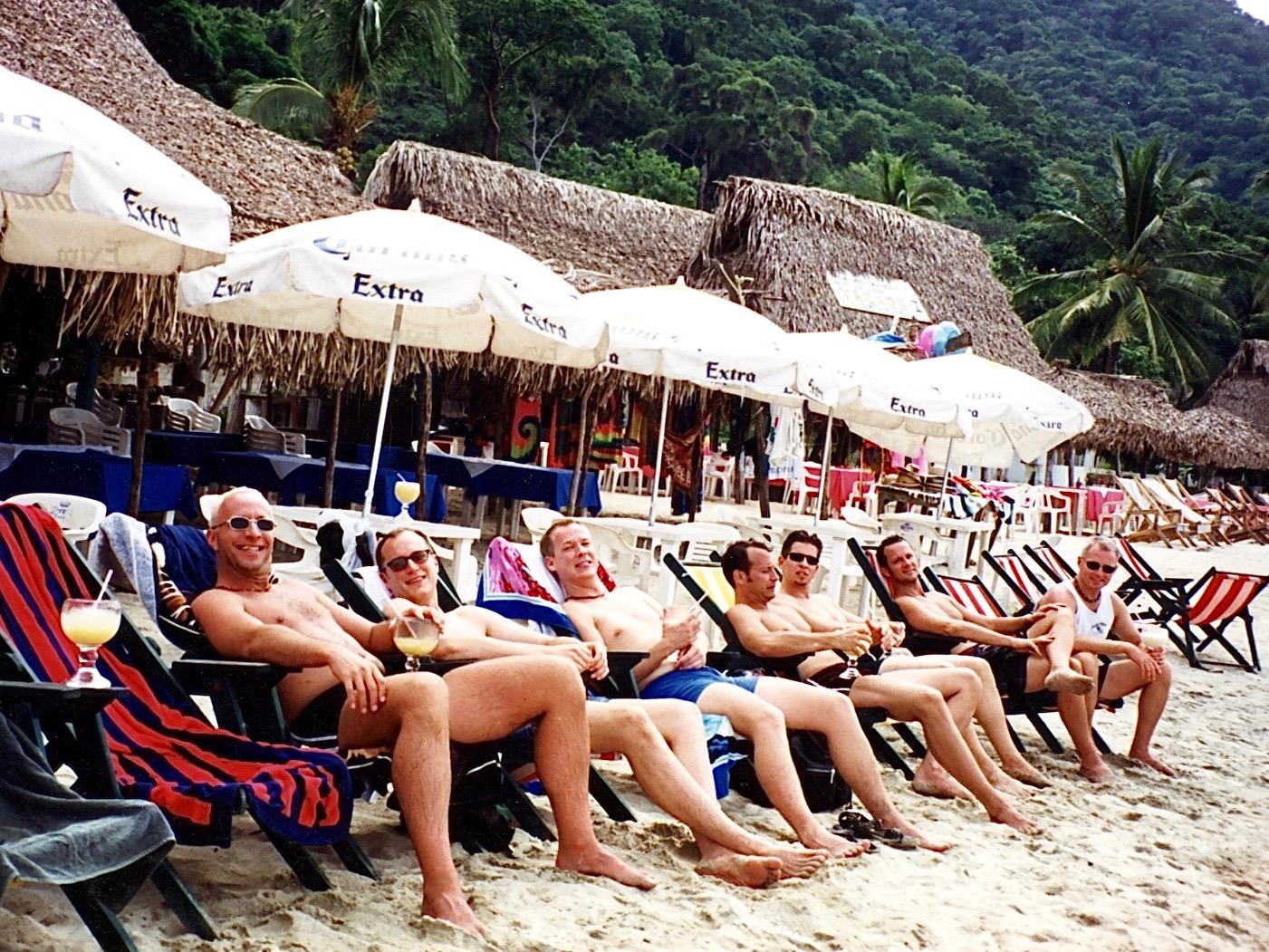 gay men on beach lounge chairs in Puerto Vallarta, Mexico