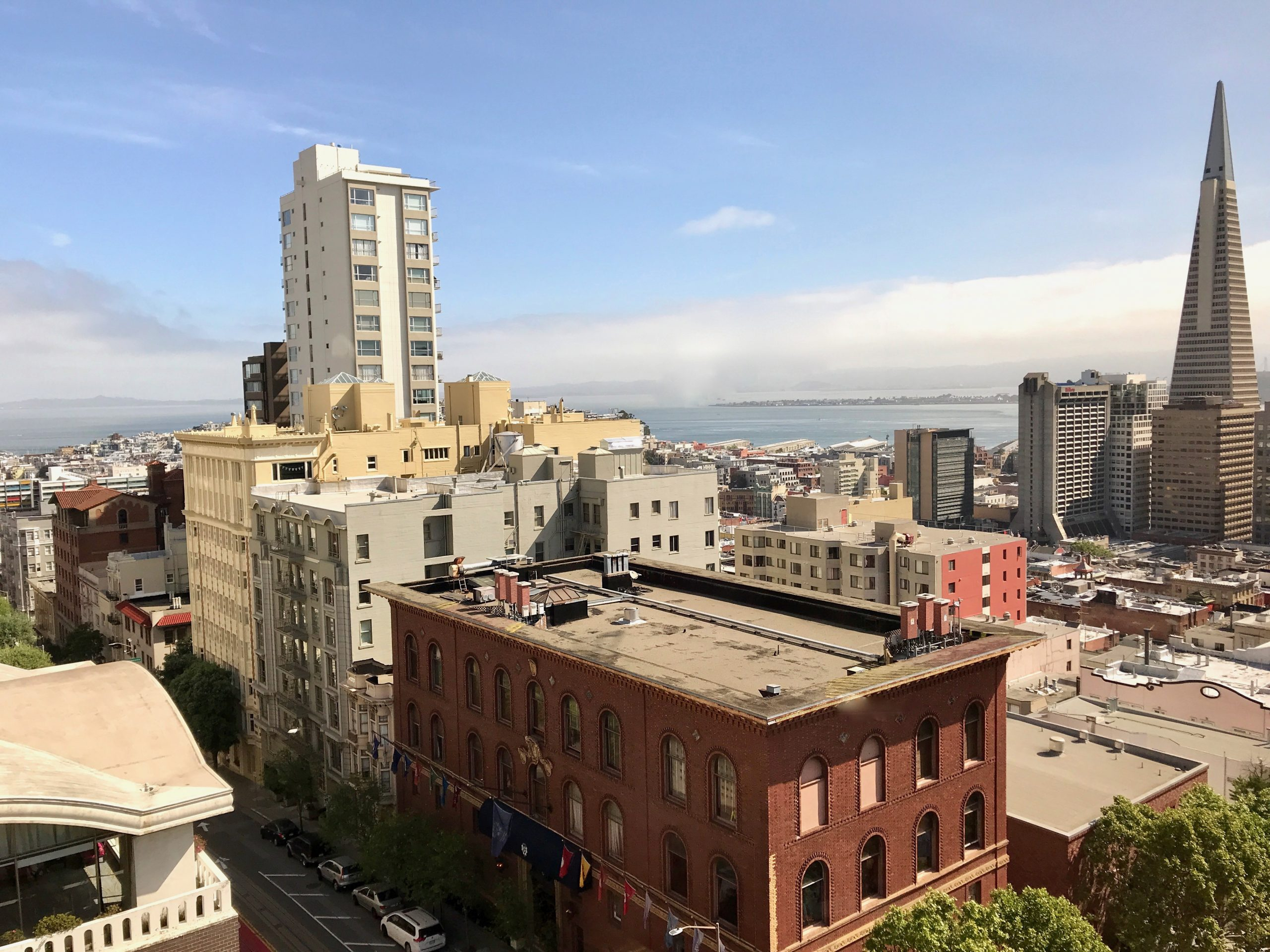Skyline of downtown San Francisco with fog bank coming in over the Bay Bridge